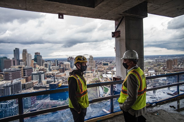 The Eleven on the River luxury condos are under construction in Minneapolis. The City Council voted unanimously to eliminate minimum parking requireme