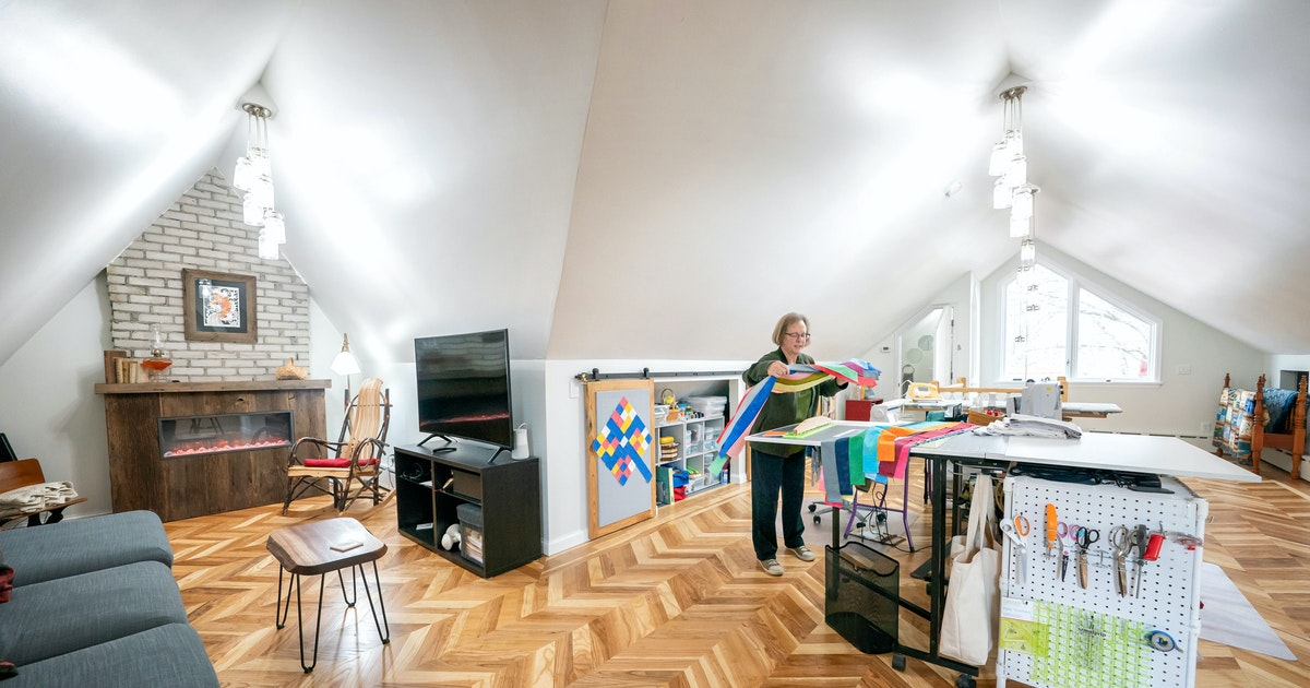Dark unfinished attic in Minneapolis is transformed into airy hobby room