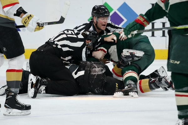 Matt Dumba (24) and Vegas Golden Knights center Ryan Carpenter (40) were separated by officials during a game at the X last month.