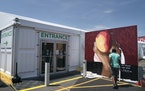 Artist Reggie LeFlore painted a mural outside the temporary Cub Foods tent in July 2020. The main store had closed after it was damaged and looted dur