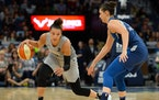 Las Vegas Aces guard Kayla McBride (21) moved the ball against Minnesota Lynx forward Cecilia Zandalasini (9) during a 2018 game.