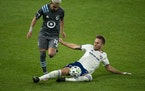 FC Dallas defender Bressan made a sliding tackle against Minnesota United midfielder Emanuel Reynoso last November at Allianz Field.