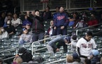 RENEE JONES SCHNEIDER • renee.jones@startribune.com Fans looked up to spot a foul ball during the Minnesota Twins verses Oakland AÕs game at Target