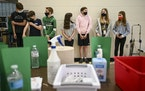 A group of masked South View Middle School students waited nervously for their first doses of the Pfizer-BioNTech COVID-19 vaccine Friday afternoon in