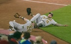 Oakland Athletics third baseman Matt Chapman (26) and Oakland Athletics left fielder Seth Brown (15) collapsed together as they tried to dive for a fo