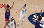 Phoenix Mercury forward Brianna Turner (21), left, and Phoenix Mercury guard Skylar Diggins-Smith (4), right, celebrated their 77-75 win as Minnesota