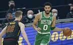 Boston's Jayson Tatum drove against Cleveland's Dean Wade on Wednesday.