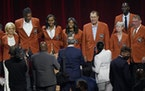 Members of the 2020 Basketball Hall of Fame class posed for a photo on stage in their Hall of Fame jackets after a tip-off celebration and awards gala