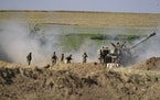 An Israeli artillery unit fires toward targets in Gaza Strip, at the Israeli Gaza border, Saturday, May 15, 2021. (AP Photo/Ariel Schalit)