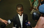 Budding young journalist Damon Weaver is greeted by the media on August 14, 2009, at the Palm Beach International Airport.