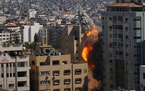 An Israeli airstrike hits the high-rise building housing The Associated Press' offices in Gaza City, Saturday, May 15, 2021.