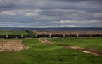A long train carrying oil tank cars traveled west in 2013 near Gladstone, N.D.