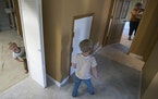 Utah transplant Rachel Bryant and her sons Ezra, 3, and Seth, 5, in the basement of their new Elk River home.