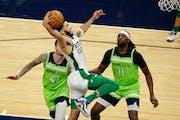 Celtics forward Jayson Tatum put up a shot against Juancho Hernangomez and Naz Reid in the third quarter Saturday.
