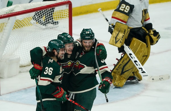 Kirill Kaprizov, center, celebrated with Mats Zuccarello and Ryan Hartman after a Wild goal earlier this month against Vegas.