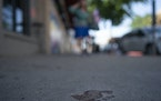 A bare bloody footprint remained on the sidewalk in the 2900 block of Hennepin Avenue for an early morning shooting N.