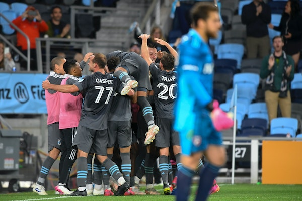 Minnesota United teammates swarmed Robin Lod after the midfielder's winning stoppage-time goal against FC Dallas on Saturday night at Allianz Field.