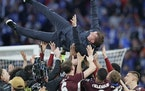 Leicester's manager Brendan Rodgers is thrown into the air by his players as they celebrated at the end of the FA Cup final in London.