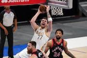 Mavericks star Luka Doncic put up a shot against the Raptors on Friday.