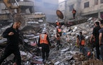 A building turned to rubble after an Israeli airstrike in Gaza City, Gaza Strip, May 16, 2021. The Israeli bombing in Gaza City killed at least 33 peo