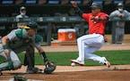 Twins second baseman Jorge Polanco scored on a sacrifice fly as Athletics catcher Sean Murphy awaited a throw Sunday at Target Field.