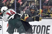Joel Eriksson Ek of the Wild defended against Golden Knights winger Ryan Reaves during the second period Sunday in Vegas.