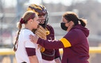 Gophers coach Piper Ritter talked to pitcher Amber Fiser and catcher Sara Kinch earlier this season.