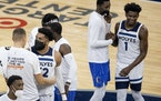Karl-Anthony Towns (32) and Anthony Edwards (1) of the Minnesota Timberwolves greeted Dallas Mavericks players at the end of the game.