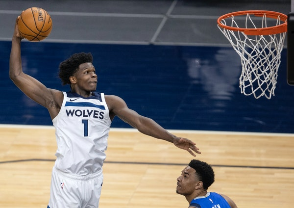 In the final game of his rookie season, Anthony Edwards dunked the ball past Dallas' Tyler Bey on Sunday.