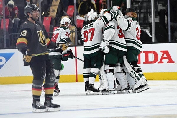 Wild players celebrate their overtime victory over the Golden Knights in Game 1 of their playoff series Sunday in Las Vegas.