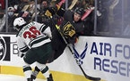 Minnesota Wild right wing Mats Zuccarello (36) hits Vegas Golden Knights defenseman Brayden McNabb (3) on Sunday.