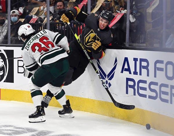 Minnesota Wild right wing Mats Zuccarello (36) hits Vegas Golden Knights defenseman Brayden McNabb (3) on Sunday.