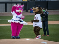 Mudonna and T.C. Bear joined St. Paul Mayor Melvin Carter for the ceremonial first pitch at the St. Paul Saints home opener.