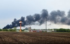 Smoke billows from a train derailment, Sunday, May 16, 2021, in Sibley, Iowa. Union Pacific spokeswoman Robynn Tysver said about 47 railcars came off