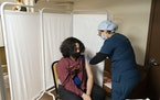 A person receives a COVID-19 vaccine at a vaccination site in a church in New York on April 26.