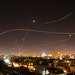Israel's Iron Dome anti-missile system fires interception missiles as rockets are launched from Gaza toward Israel on May 16.