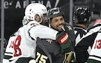 Vegas forward Ryan Reaves smiled after getting into a scuffle with the Wild's Ian Cole during the second period Sunday.