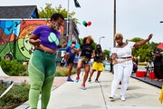 Community members did the electric slide last summer during an event in north Minneapolis organized by TruArtSpeaks, one of 10 Minnesota arts groups t
