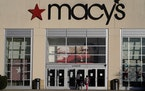 FILE - In this Feb. 22, 2021 file photo, shoppers arrive at a Macy's in Charlotte, N.C. Macy's emerged from an unprecedented year by swinging to a