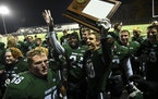 Mounds View players celebrated with their 6A section trophy Friday night after defeating Buffalo.