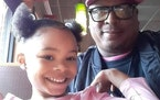 K.G. Wilson, with his granddaughter Aniya, who was shot Monday. Her name has not been disclosed.  Credit: Provided by K.G. Wilson