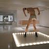 "An actual go-go dancer (Scott Edward Stafford) pops up regularly on Felix González-Torres' sculpture ""Untitled (Go-Go Dancing Platform)"" as par"