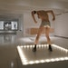 "An actual go-go dancer (Scott Edward Stafford) pops up regularly on Felix González-Torres' sculpture ""Untitled (Go-Go Dancing Platform)"" as par"
