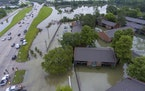 In this photo taken by a drone is an aerial view of the flooded Siegen Calais apartments Tuesday, May 18, 2021, in Baton Rouge, La. Heavy rains have s