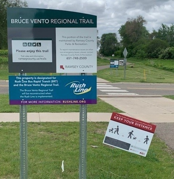 New signs with information about the Rush Line have appeared along the Bruce Vento Regional Trail in Ramsey County.