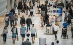 People shop at the Mall of America on the day the governor lifted the mask mandate for Minnesota.