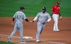 White Sox designated hitter Yermin Mercedes celebrated his home run with third base coach Joe McEwing