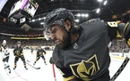 David Becker • Associated Press Vegas right wing Alex Tuch handles the puck on the boards against the Wild during the second period of Game 1.