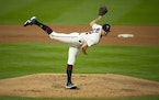 Minnesota Twins starting pitcher Bailey Ober followed through while throwing to the White Sox in the second inning. He was making his major league deb