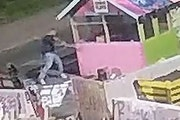 This image is from surveillance video that captured a man taking an ax to a structure over the weekend at George Floyd Square.  Credit: Provided by Ge